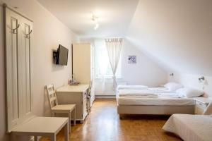 Łóżko lub łóżka w pokoju w obiekcie Lavender - Restauracja i pokoje gościnne