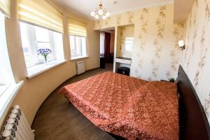 Кровать или кровати в номере Семь ветров Гостевой дом