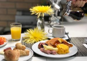 Breakfast options available to guests at Hotel Poblado Natura