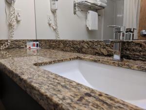 A bathroom at Super 8 by Wyndham Portage La Prairie MB
