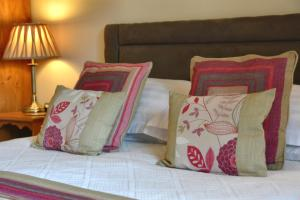 A bed or beds in a room at The Crown Country Inn