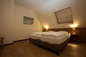 Een bed of bedden in een kamer bij Parc Ganuenta