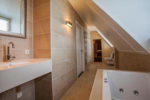 Een badkamer bij Parc Ganuenta