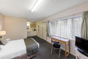 A television and/or entertainment center at Best Western Adelaide Granada Motor Inn