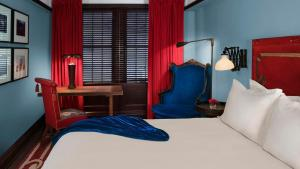 A bed or beds in a room at Gramercy Park Hotel