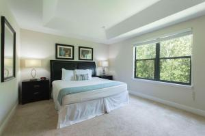 A bed or beds in a room at The Fountains Resort Orlando at ChampionsGate