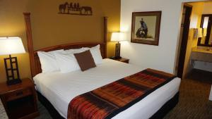 A bed or beds in a room at Best Western Grande River Inn & Suites