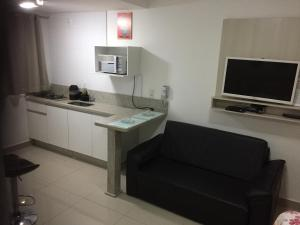 A television and/or entertainment centre at Flat Service Areiao