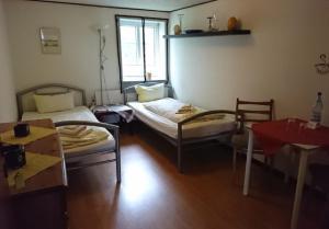 Ein Bett oder Betten in einem Zimmer der Unterkunft Ferienzimmervermietung Reitferien