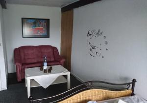 Ein Sitzbereich in der Unterkunft Ferienzimmervermietung Reitferien
