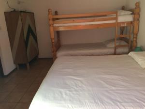 A bunk bed or bunk beds in a room at Hôtel Le Tuc de l'Etang