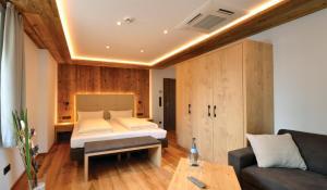 Ein Bett oder Betten in einem Zimmer der Unterkunft Landgasthof Hotel Scheubel