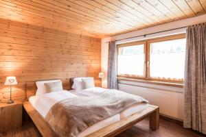 Ein Bett oder Betten in einem Zimmer der Unterkunft Hotel Suretta