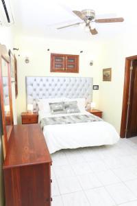 Ein Bett oder Betten in einem Zimmer der Unterkunft Hotel Aluge