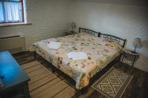 Ліжко або ліжка в номері Dacha
