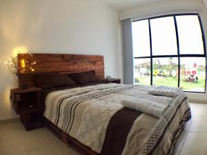 A bed or beds in a room at Moderna casa 3 recámaras cerca Zona Industrial