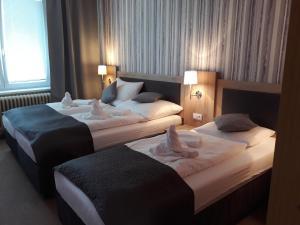 Postel nebo postele na pokoji v ubytování Hotel Rozvoj