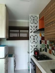 A kitchen or kitchenette at Cumbuco vg sun