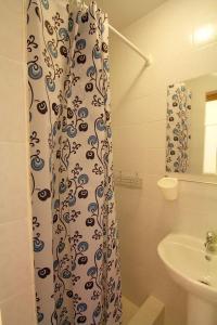 Ванная комната в Guest House Uyutniy Dvorik