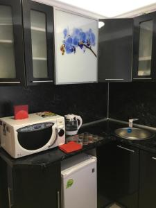 A kitchen or kitchenette at Apartments at Moskovskaya 20