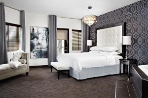 A bed or beds in a room at Four Points by Sheraton Calgary West