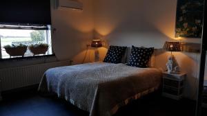 Een bed of bedden in een kamer bij Logement Hellevoetsluis