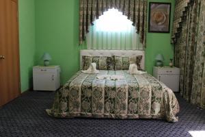 Кровать или кровати в номере Гостевой дом Визит