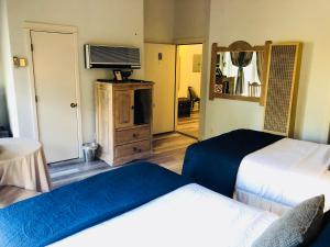 A bed or beds in a room at Hotel San Ramon