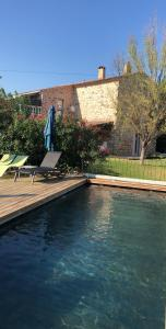 The swimming pool at or near La Bastide de l'Olivier