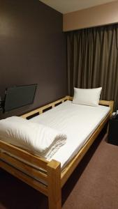 A bed or beds in a room at Tokyo Ariake Bay Hotel