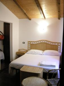 A bed or beds in a room at 'A Cunziria