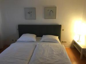 Ein Bett oder Betten in einem Zimmer der Unterkunft Apartment Roxheim