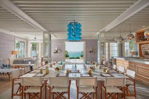A restaurant or other place to eat at Mandarin Oriental, Canouan