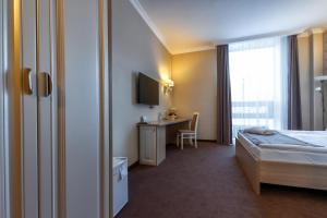 AYKUN Hotelにあるベッド