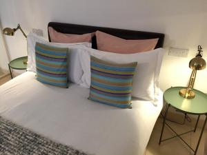 A bed or beds in a room at The Luxury Inn