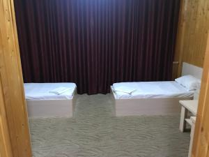 Кровать или кровати в номере Daymohk