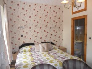 A bed or beds in a room at Armadale Guest House