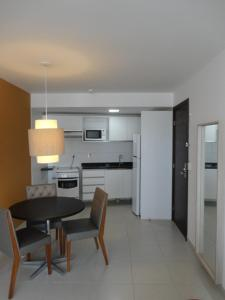 A kitchen or kitchenette at Beach Class Convention & Flats