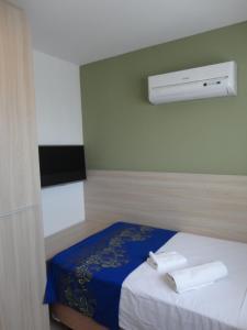 A bed or beds in a room at Lindo Flat em Boa Viagem 2 qtos