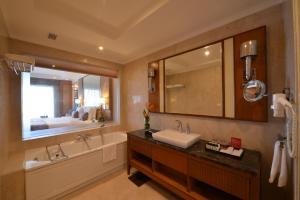 A bathroom at Ramada Plaza Chennai