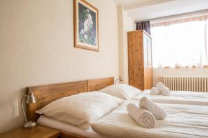 Posteľ alebo postele v izbe v ubytovaní Apartmany Belianky