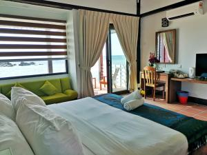 A bed or beds in a room at Paya Beach Spa & Dive Resort