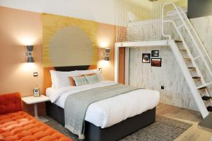A bed or beds in a room at room2 Southampton Hometel