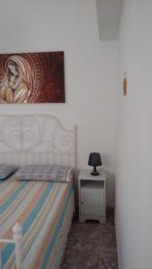 A bed or beds in a room at Mini appartamento da Cetty
