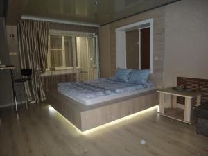 A bed or beds in a room at Васильева 1