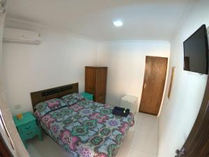 Cama ou camas em um quarto em Pousada Costa da Riviera