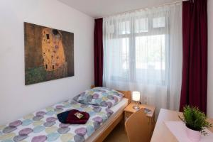 Ein Bett oder Betten in einem Zimmer der Unterkunft Abendrot Appartement