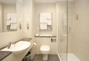 A bathroom at Best Western Woodlands Hotel