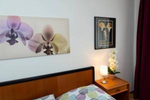 Ein Bett oder Betten in einem Zimmer der Unterkunft Morgentau Appartement