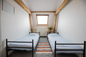 A bed or beds in a room at Jorplace Beach Hostel